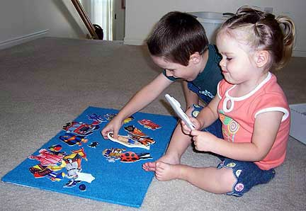 Boy and Girl Playing with Felt Paperdolls